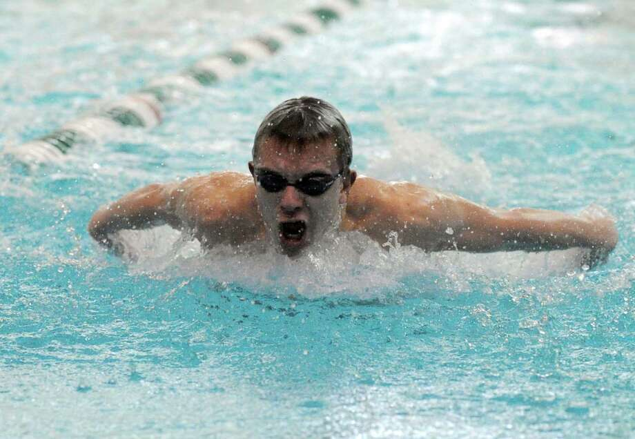 Shaker's Andrew Semmes competes in the 100m butterfly during their meet against Shenendehowa on Thursday Jan. 17,2013 in Clifton Park, N.Y. (Michael P. Farrell/Times Union) Photo: Michael P. Farrell