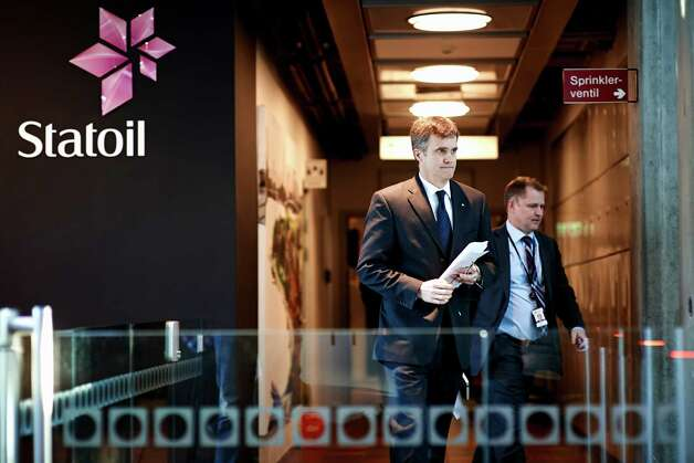 Statoil CEO Helge Lund, left, and Director of Foreign Operations, Lars Christian Bacher, exit from a meeting at Statoil head quarters building in Stavanger, Norway, Thursday Jan, 17, 2013.  Algerian forces raided the remote Amenas gas plant on Thursday in an attempt to free dozens of foreign hostages held by militants with ties to Mali's rebel Islamists, according to diplomats on Thursday, and Islamic militants claim that 35 hostages and 15 militants were killed after Algerian military helicopters strafed the area but said seven hostages survived.  (AP Photo / Kent Skibstad, NTB scanpix) NORWAY OUT Photo: Kent Skibstad