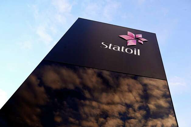 The sign outside the Statoil oil company headquarters in Stavanger, Norway, Thursday Jan. 17, 2013. Statoil's gas plant in Algerie has been attacked and Norwegians are reported to be among workers who are taken as hostage.  Algerian forces raided the remote In Amenas gas plant on Thursday in an attempt to free dozens of foreign hostages held by militants with ties to Mali's rebel Islamists, according to diplomats on Thursday, and Islamic militants claim that 35 hostages and 15 militants were killed after Algerian military helicopters strafed the area but said seven hostages survived. (AP Photo / Kent Skibstad, NTB scanpix) NORWAY OUT Photo: KENT Skibstad