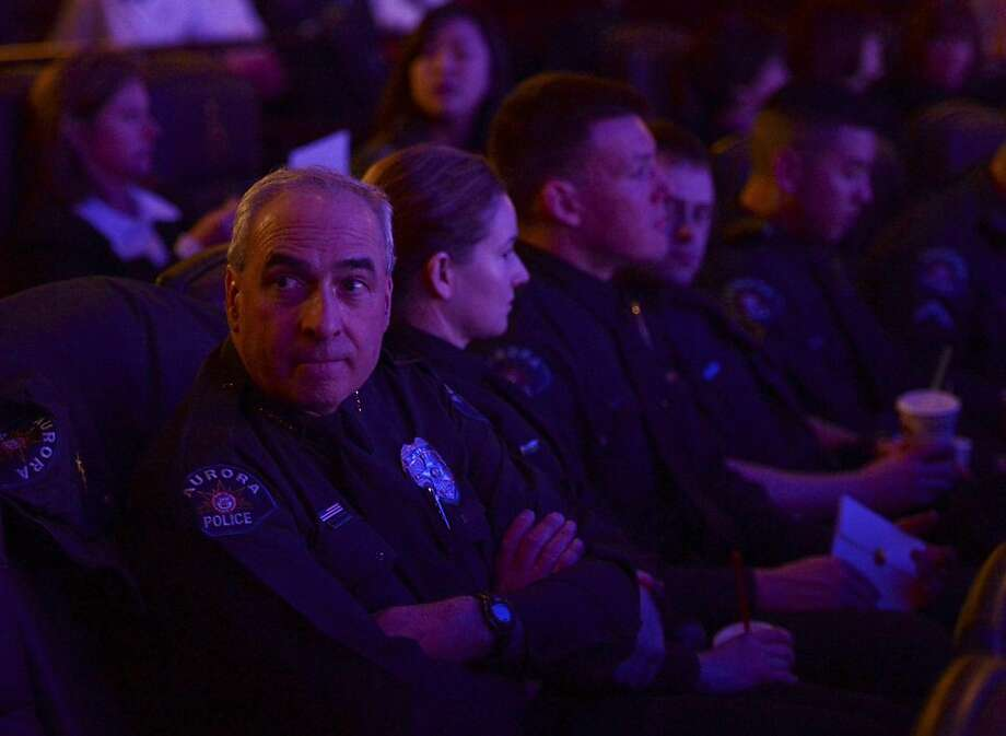 Aurora Police Chief Daniel J. Oates attends the reopening and remembrance ceremony at the Century Aurora cinema, formerly the Century 16, Thursday, Jan. 17, 2013 in Aurora, Colo. The cinema is where 12 people were killed and dozens injured in a shooting rampage last July. Photo: RJ Sangosti, Associated Press