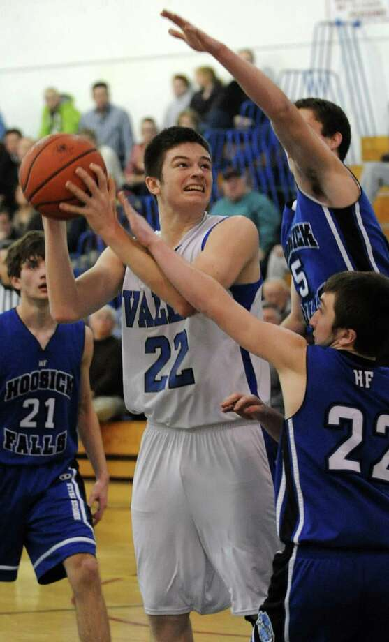 Hoosic Valley's John Rooney is double teamed as he drives to the hoop during a basketball game against Hoosick Falls on Thursday Jan. 17, 2013 in Schaghticoke, N.Y.  (Lori Van Buren / Times Union) Photo: Lori Van Buren