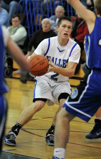 Hoosic Valley's Mac Anderson looks for a shot at the hoop during a basketball game against Hoosick F