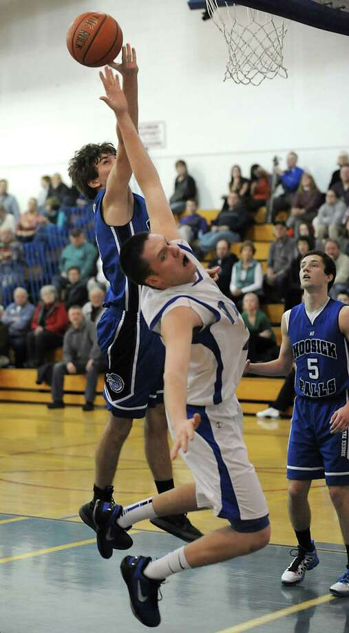 Hoosick Falls' Levi Brewster and Hoosic Valley's Ethan Ross-Hixson both fall on this play during a basketball game on Thursday Jan. 17, 2013 in Schaghticoke, N.Y.  (Lori Van Buren / Times Union) Photo: Lori Van Buren