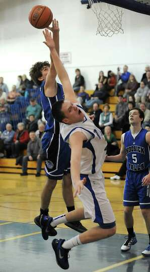 Hoosick Falls' Levi Brewster and Hoosic Valley's Ethan Ross-Hixson both fall on this play during a b