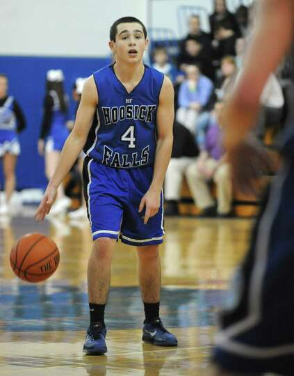 Hoosick Falls' Andrew Hoag dribbles the ball during a basketball game against Hoosic Valley on Thurs