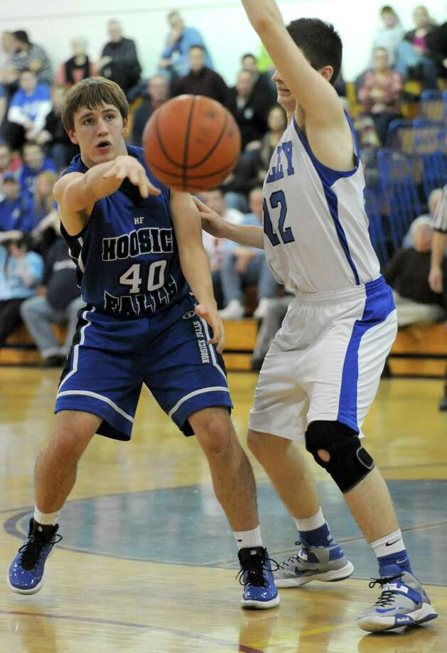Hoosick Falls' Austin Pitt passes the ball around Hoosic Valley's John Rooney during a basketball game on Thursday Jan. 17, 2013 in Schaghticoke, N.Y.  (Lori Van Buren / Times Union) Photo: Lori Van Buren