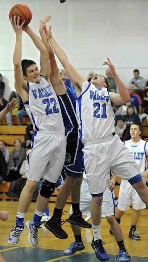 Hoosic Valley's John Rooney, #22, and Ethan Ross-Hixson, #21, go up for a rebound against Hoosick Fa