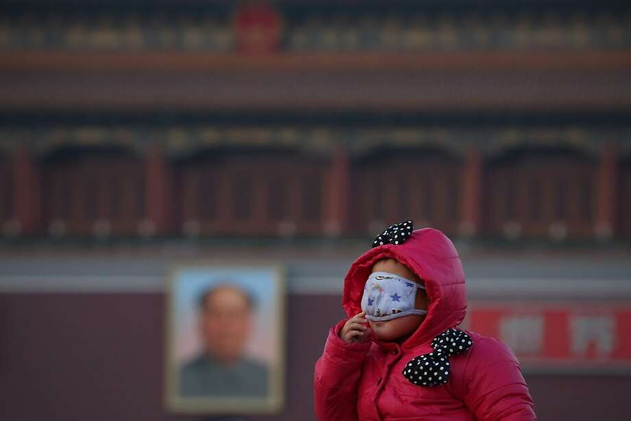 A little tourist wearing the mask at the Tiananmen Square during slight pollution on January 17, 2013 in Beijing, China. Photo: Feng Li, Getty Images