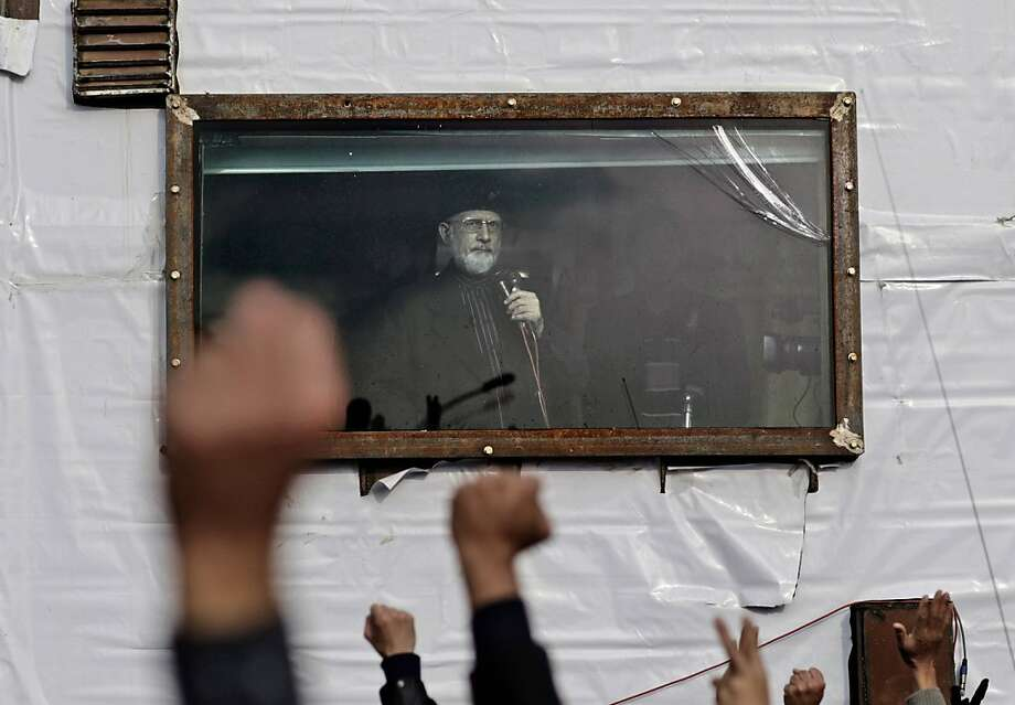 Pakistani Sunni cleric Tahir-ul-Qadri addresses his supporters from his bullet-proof container, during an anti-government rally in Islamabad, Pakistan, Thursday, Jan. 17, 2013. Qadri is demanding the government be dissolved and replaced with a caretaker administration formed in consultation with the judiciary and the military. He also wants electoral reform to weed out corrupt politicians and prevent them from winning elections in the future. Photo: Muhammed Muheisen, Associated Press