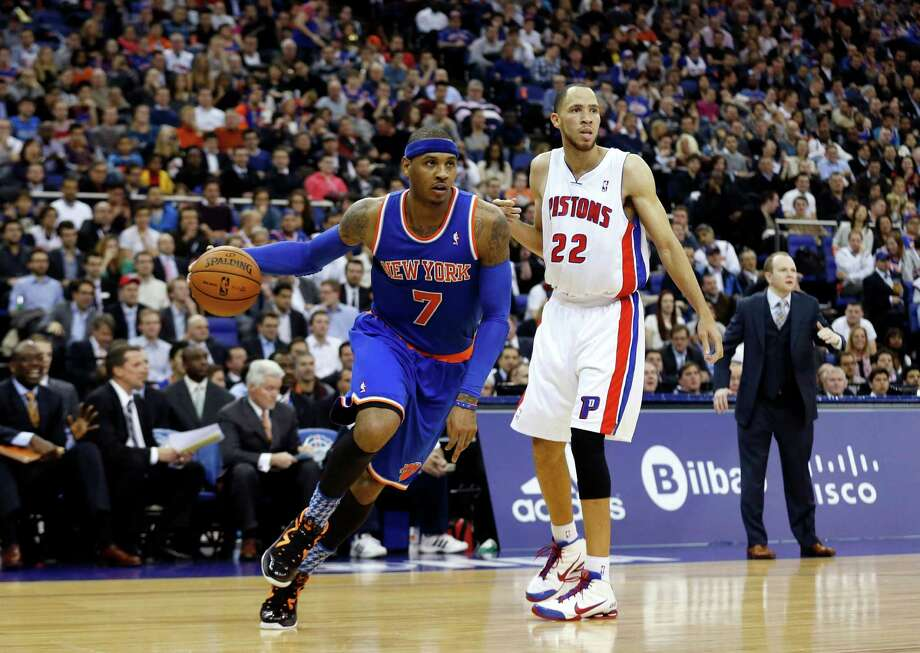 New York Knicks forward Carmelo Anthony, left, takes the ball past Detroit Pistons forward Tayshaun Prince during their NBA basketball game at the 02 arena in London, Thursday, Jan. 17, 2013.  (AP Photo/Matt Dunham) Photo: Matt Dunham