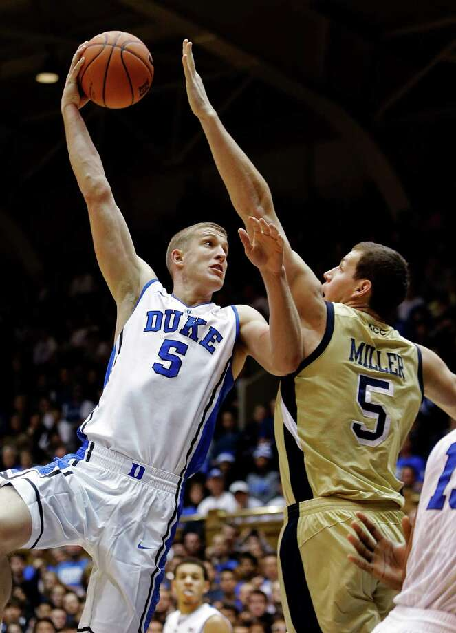 Duke's Mason Plumlee (5) shoots over Georgia Tech's Daniel Miller (5) during the first half of an NCAA college basketball game in Durham, N.C., Thursday, Jan. 17, 2013. (AP Photo/Gerry Broome) Photo: Gerry Broome