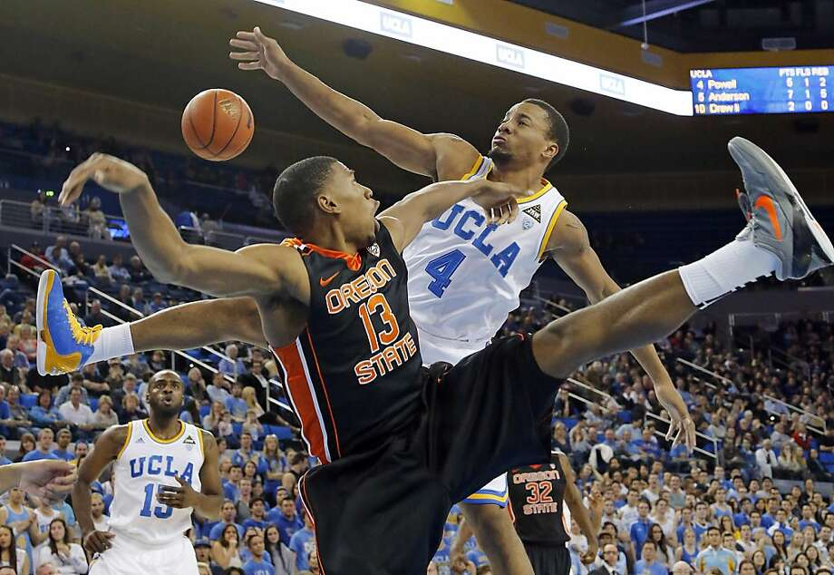 Oregon State's Langston Morris-Walker and UCLA's Norman Powell compete for the ball in the first half. Shabazz Muhammad had 21 points as the Pac-12 leaders won their 10 straight. Photo: Reed Saxon, Associated Press