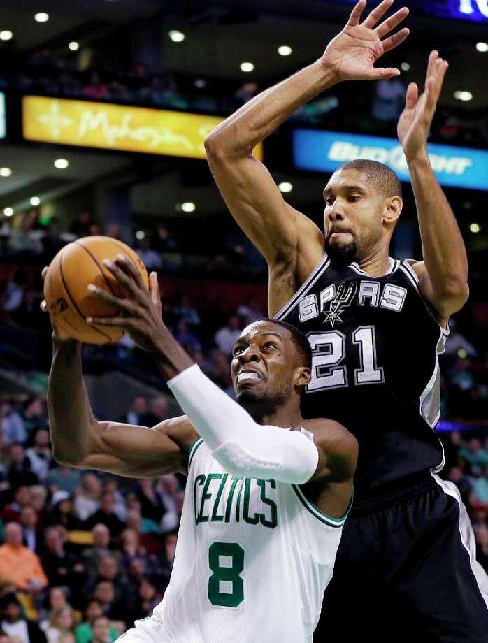 Spurs power forward Tim Duncan (21) defends against Boston Celtics forward Jeff Green (8) during the second half in Boston, Wednesday, Nov. 21, 2012. The Spurs won 112-100. Photo: Elise Amendola, Associated Press / AP