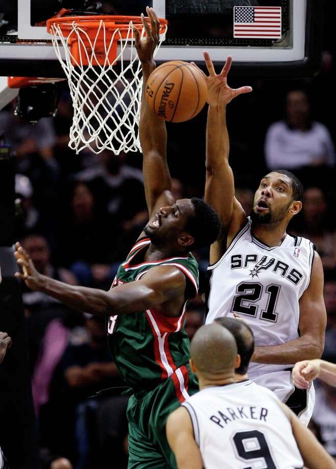 The Spurs' Tim Duncan tries to block Milwaukee Bucks' Ekpe Udoh during the second half at the AT&T Center, Wednesday, Nov. 5, 2012. The Spurs won 110-99. Photo: Jerry Lara, San Antonio Express-News / © 2012 San Antonio Express-News