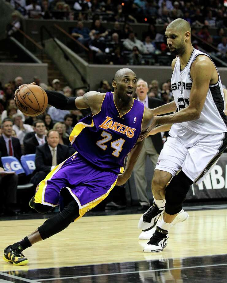 The Spurs' Tim Duncan (21) guards Los Angeles Lakers' Kobe Bryant (24) in the second half at the AT&T Center on Wednesday, Jan. 9, 2013. Spurs defeated the Lakers, 108-105. Photo: Kin Man Hui, San Antonio Express-News / © 2012 San Antonio Express-News