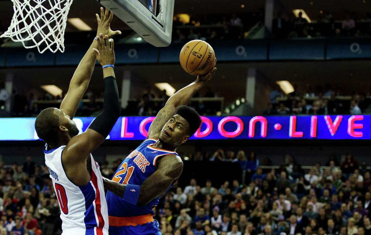 """Knicks guard Iman Shumpert, right, brought a bit of American flair to a matchup with Greg Monroe and the """"host"""" Pistons in London."""