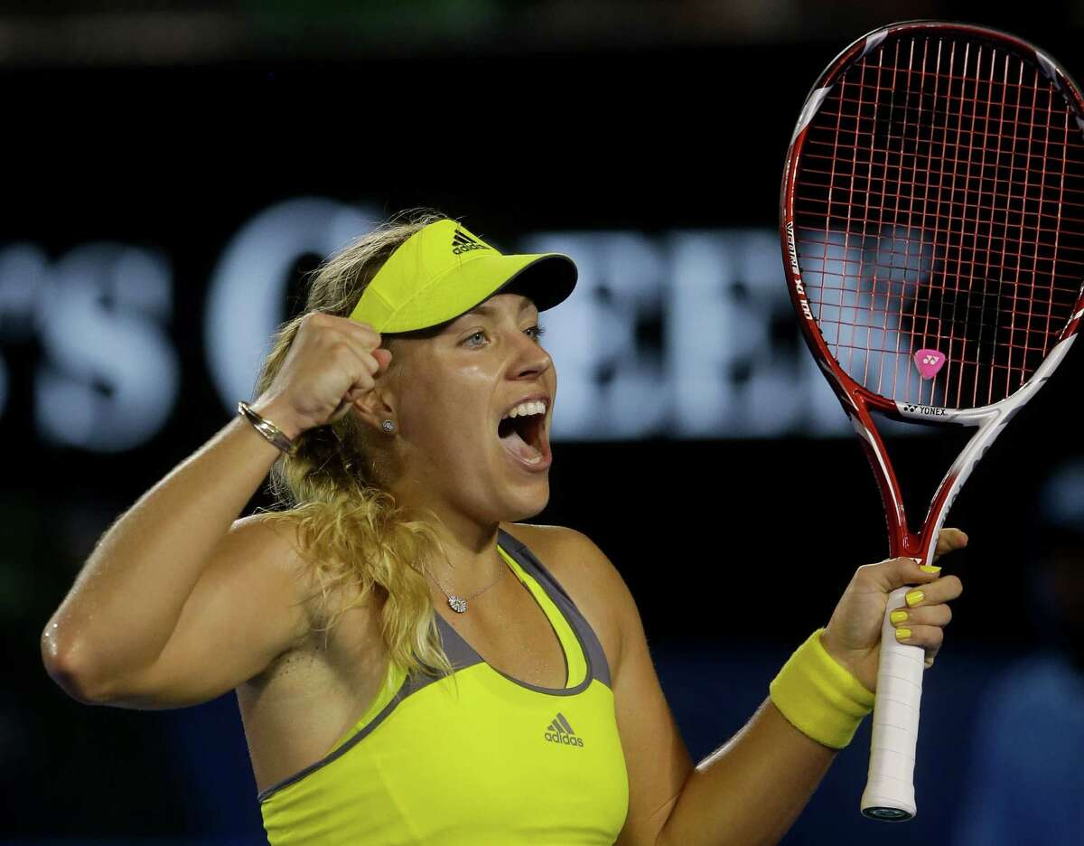 Germany's Angelique Kerber celebrates after defeating Madison Keys of the US in their third round match at the Australian Open tennis championship in Melbourne, Australia.