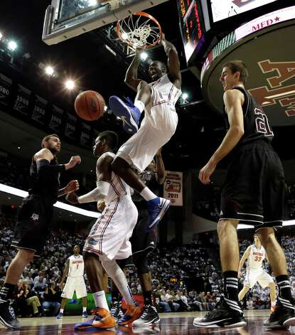 Florida's Patric Young (4) dunks the ball as Texas A&M's Alex Caruso (21) watches during the second half of an NCAA college basketball game on Thursday, Jan. 17, 2013, in College Station, Texas. Florida defeated Texas A&M 68-47. (AP Photo/David J. Phillip) Photo: David J. Phillip, Associated Press / AP