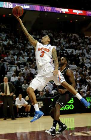 Florida's Mike Rosario (3) shoots as Texas A&M's Kourtney Roberson defends during the first half of an NCAA college basketball game on Thursday, Jan. 17, 2013, in College Station, Texas. (AP Photo/David J. Phillip) Photo: David J. Phillip, Associated Press / AP