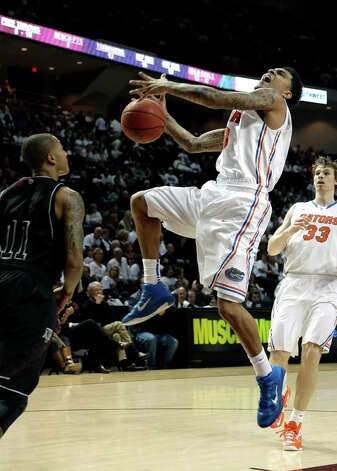 Florida's Mike Rosario, right, loses the ball as he goes up to shoot as Texas A&M's J'Mychal Reese (11) defends during the second half of an NCAA college basketball game on Thursday, Jan. 17, 2013, in College Station, Texas. Florida defeated Texas A&M 68-47. (AP Photo/David J. Phillip) Photo: David J. Phillip, Associated Press / AP