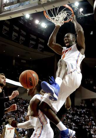 Florida's Patric Young dunks the ball against Texas A&M during the second half of an NCAA college basketball game, Thursday, Jan. 17, 2013, in College Station, Texas. Florida won 68-47. (AP Photo/David J. Phillip) Photo: David J. Phillip, Associated Press / AP