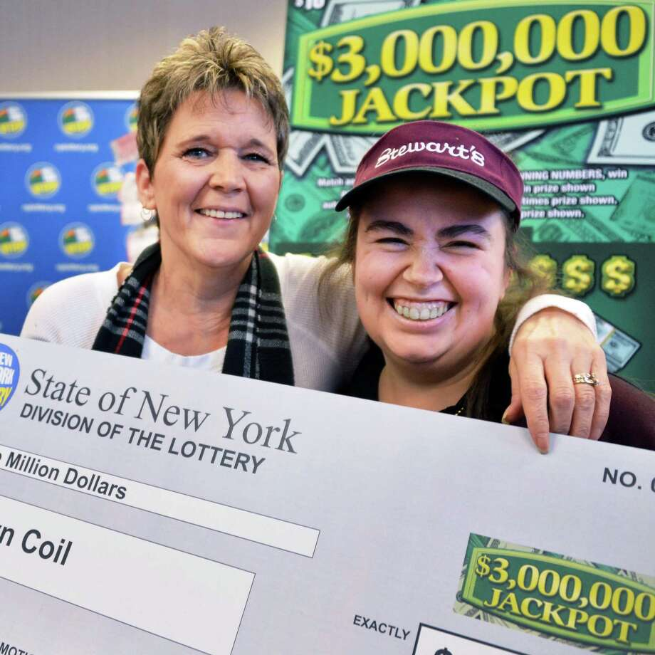 New millionaire Robyn Coil, left, of Stillwater poses with Stewart's shop employee Chelsea Russell who sold Coil her winning $3,000,000 Jackpot scratch-off ticket at the Stewart's shop in Mechanicville Thursday Jan. 17, 2013.   (John Carl D'Annibale / Times Union) Photo: John Carl D'Annibale / 00020808A