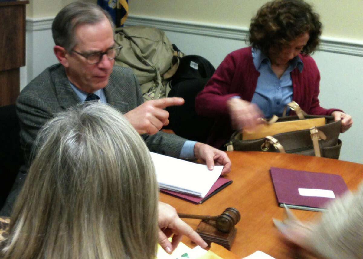 Kevin Gumpper, chairman of the Conservation Commission and flanked by commission members Catherine O'Donnell, left, and Kate Maxham at Thursday's meeting where the panel reviewed the lastest plan by Exide Group Inc. to dredge lead from the Mill River. FAIRFIELD CITIZEN, CT 1/17/13