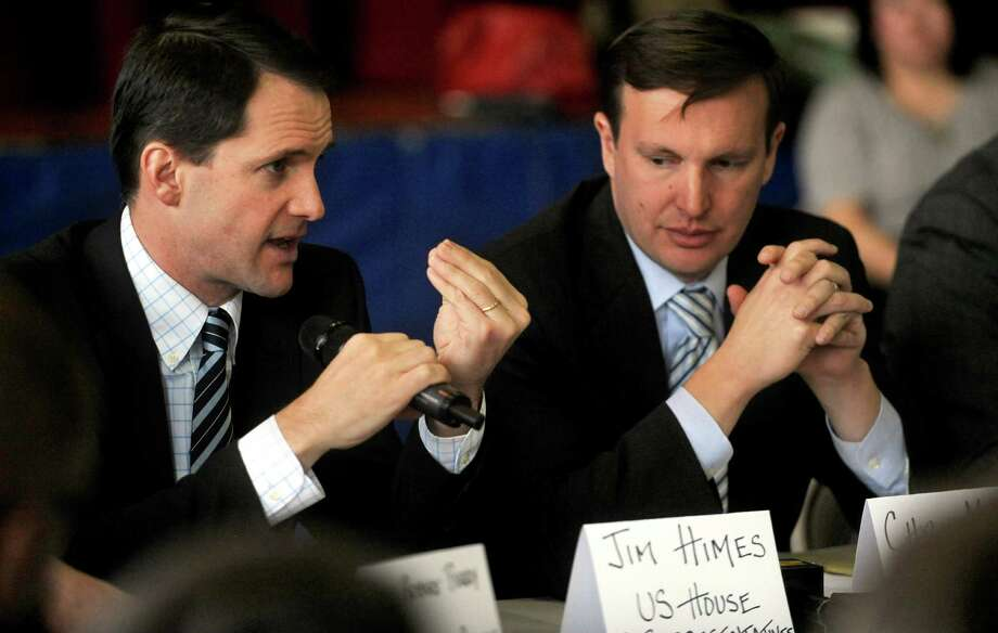U.S. Rep. Jim Himes (D-Conn.), left, speaks as he sits next to U.S. Sen. Chris Murphy (D-Conn.), right, during a roundtable discussion about curbing gun violence at the Yerwood Community Center in Stamford on Thursday, January 17, 2013. Photo: Lindsay Perry / Stamford Advocate