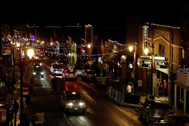 Cars drive past the marquee at the Egyptian Theatre on Main Street at night during the 2013 Sundance Film Festival on Thursday. (Photo by Danny Moloshok/Invision/AP) Photo: Ap/getty