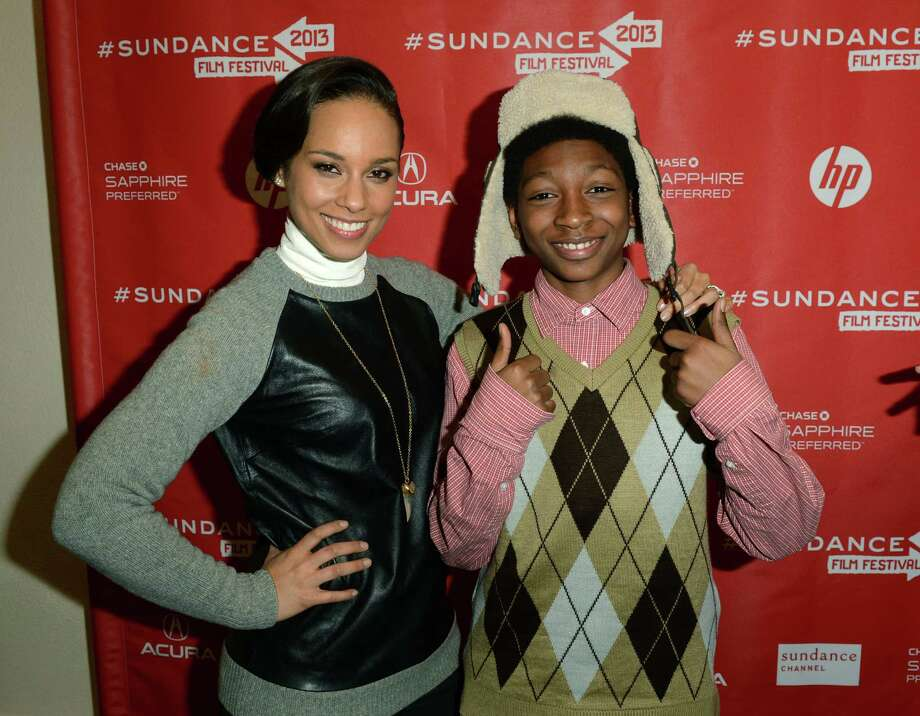 "Singer Alicia Keys making a surprise appearance and actor Skylan Brooks at the ""The Inevitable Defeat of Mister and Pete"" premiere during the 2013 Sundance Film Festival at Library Center Theater on Thursday.  (Photo by Jason Merritt/Getty Images) Photo: Jason Merritt, Ap/getty / 2013 Getty Images"