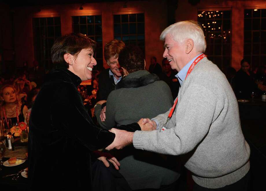 Sibylle Szaggars and Chairman and CEO of the Motion Picture Association of America Christopher Dodd -- former U.S. senator from Connecticut --attend An Artist At The Table, a benefit for the Sundance Institute during the 2013 Sundance Film Festival at The Shop on Thursday.  (Photo by Mark Davis/Getty Images) Photo: Mark Davis, Ap/getty / 2013 Getty Images