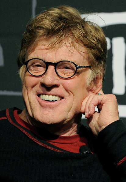 Robert Redford, founder and president of the Sundance Institute, smiles during the opening news conf