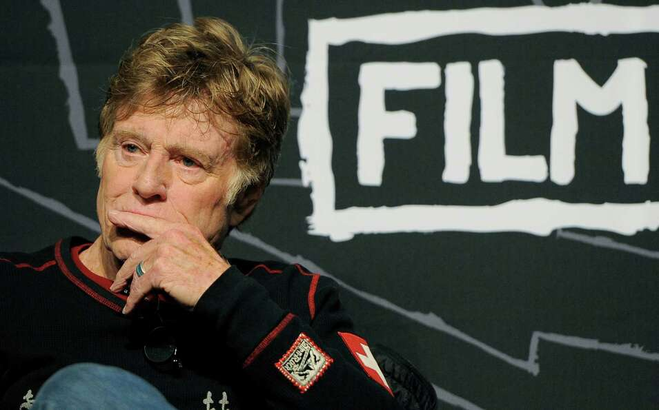 Robert Redford, founder and president of the Sundance Institute, listens to a question during the op