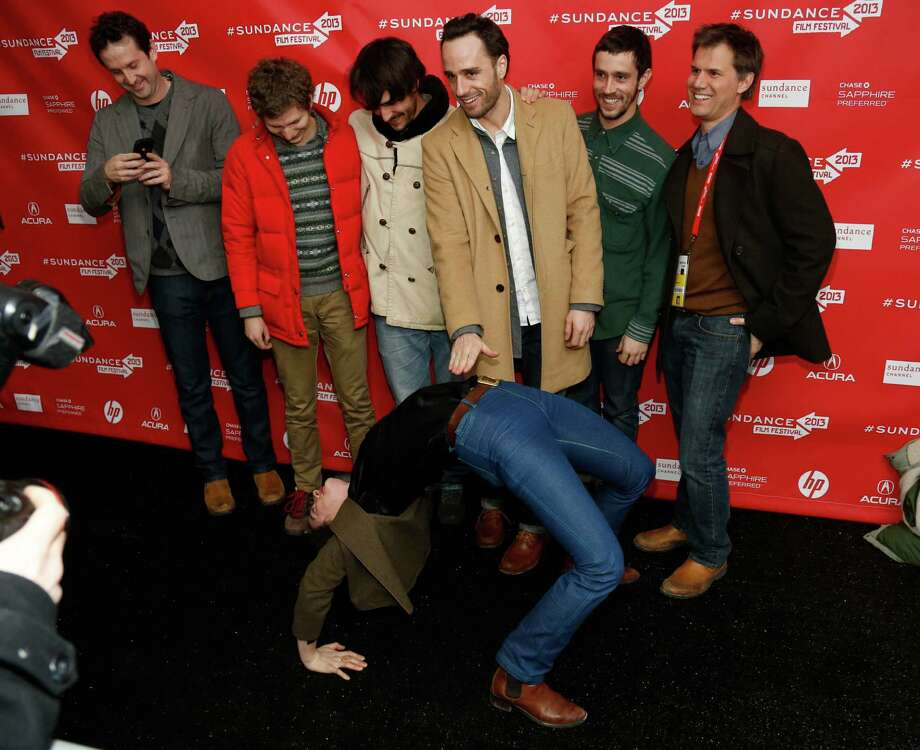 "Cast member Gaby Hoffmann leans over backwards in front of other including actor Michael Cera, second left, and director Sebastian Silva, third right, as they pose together at the premiere of ""Crystal Fairy"" during the 2013 Sundance Film Festival on Thursday. (Photo by Danny Moloshok/Invision/AP) Photo: Ap/getty"