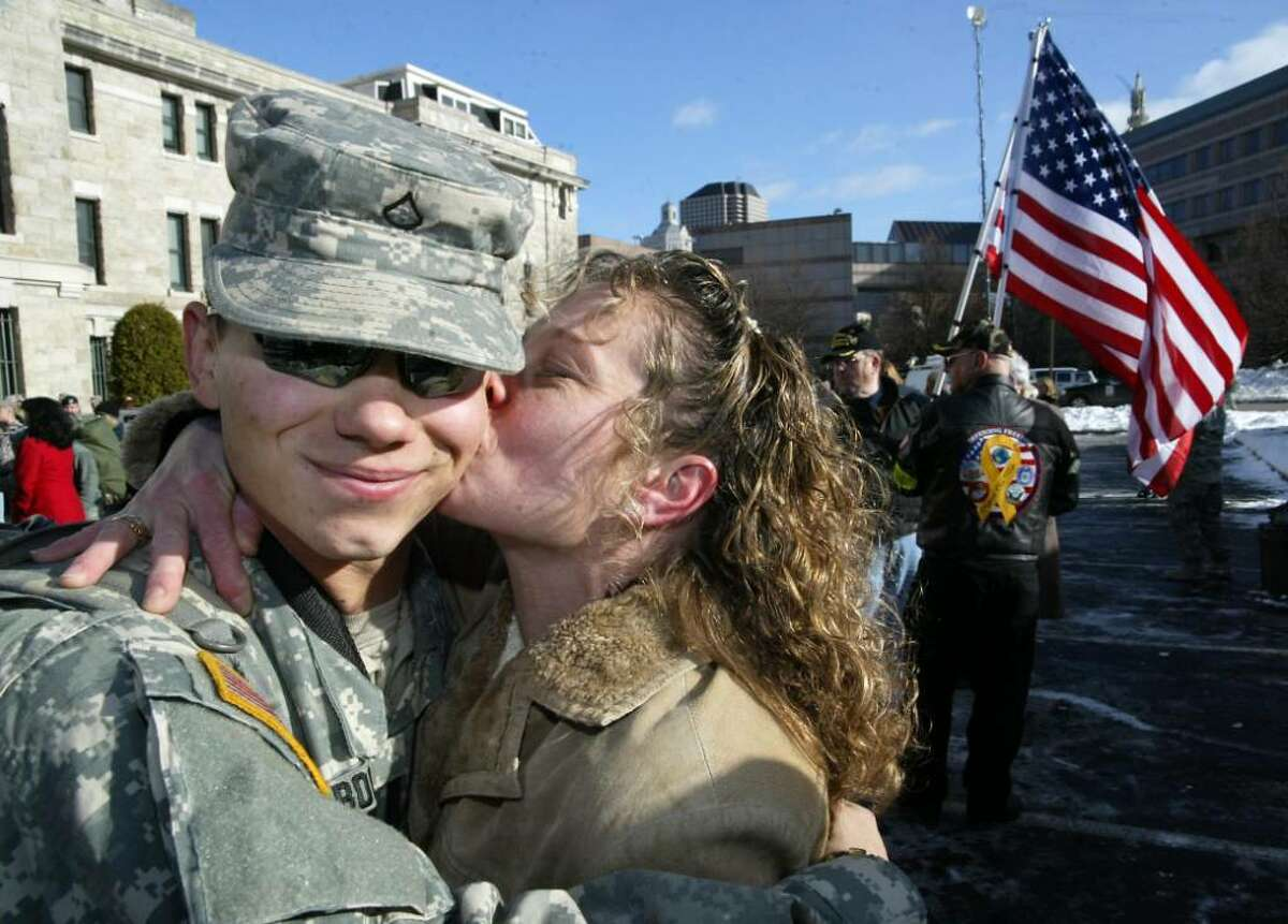Ct. National Guardsman,(L-R) Pvt Alexander Booth, 18, of Danbury, is met by his mother Victoria Booth, outside the Hartford State Armory as buses return members of the 1st Battalion, 102 Infantry Unit to Hartford from training at Ft. McCoy in Wisconsin and will return to Ft McCoy before deploying to Afganistan. Wednesday, Dec. 23, 2009