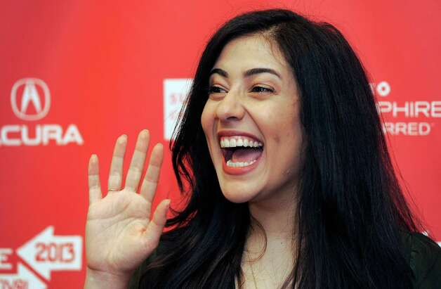 "Nadine Malouf, a cast member in ""May in the Summer,"" waves at the premiere of the film on the opening night of the 2013 Sundance Film Festival on Thursday. (Photo by Chris Pizzello/Invision/AP) Photo: Ap/getty"