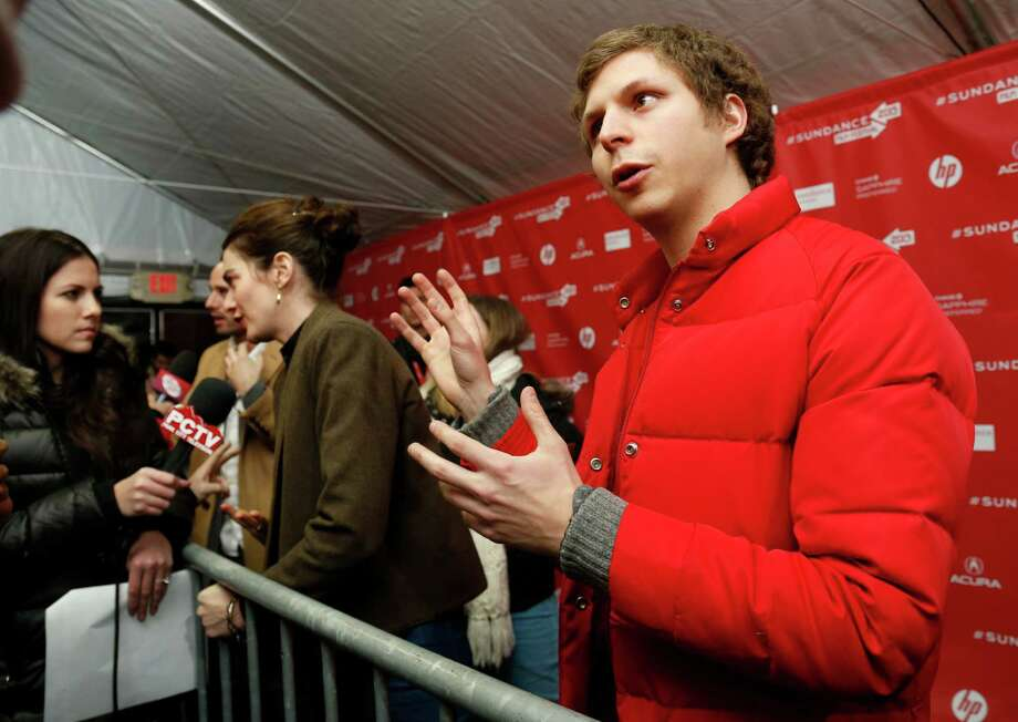 "Cast members Michael Cera, right, and Gaby Hoffmann, left, are interviewed at the premiere of ""Crystal Fairy"" during the 2013 Sundance Film Festival on Thursday. (Photo by Danny Moloshok/Invision/AP) Photo: Ap/getty"