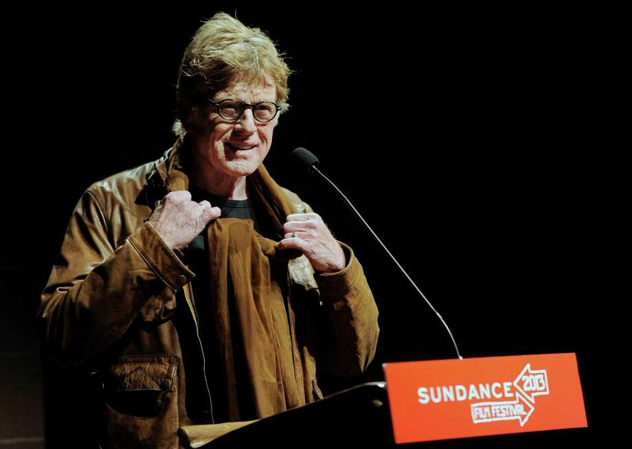 "Robert Redford, founder and president of the Sundance Institute, addresses the audience on the opening night premiere of the film ""May in the Summer"" at the 2013 Sundance Film Festival, Thursday, Jan. 17, 2013, in Park City, Utah. (Photo by Chris Pizzello/Invision/AP) Photo: Ap/getty"