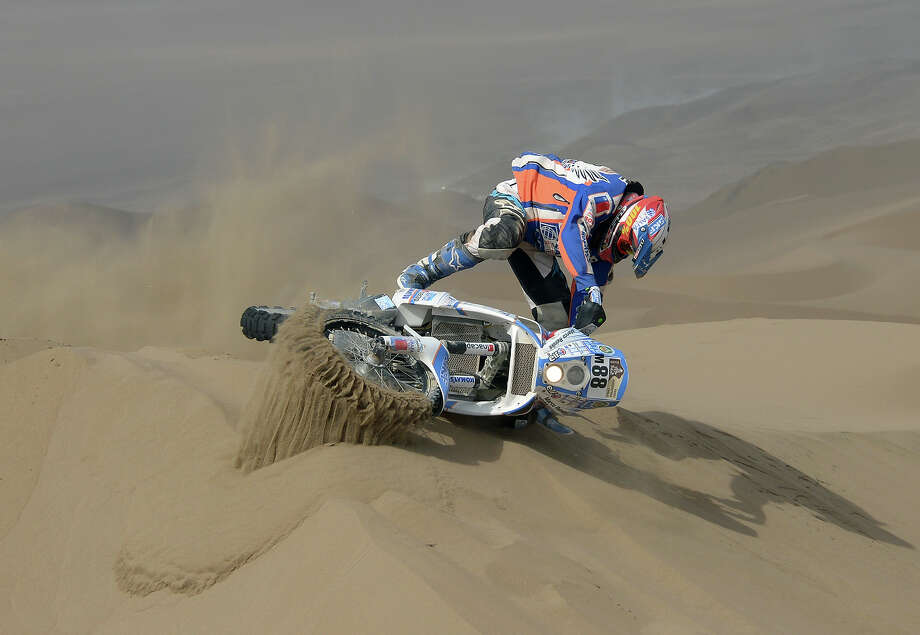 Chile's KTM biker Marco Reinike falls during the Dakar 2013 Stage 6 between Arica and Calama, Chile, on January 10, 2013. The rally is taking place in Peru, Argentina and Chile from January 5 to 20. Photo: FRANCK FIFE, AFP/Getty Images / 2013 AFP