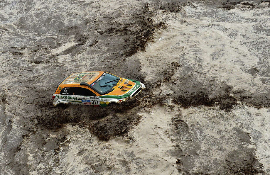 Brazil's Guilherme Spinelli is seen stuck in a flooded river during Stage 8 of the Dakar Rally 2013 between Salta and Tucuman, Argentina, on January 12, 2013. The rally takes place in Peru, Argentina and Chile from January 5-20. Photo: FRANCK FIFE, AFP/Getty Images / 2013 AFP