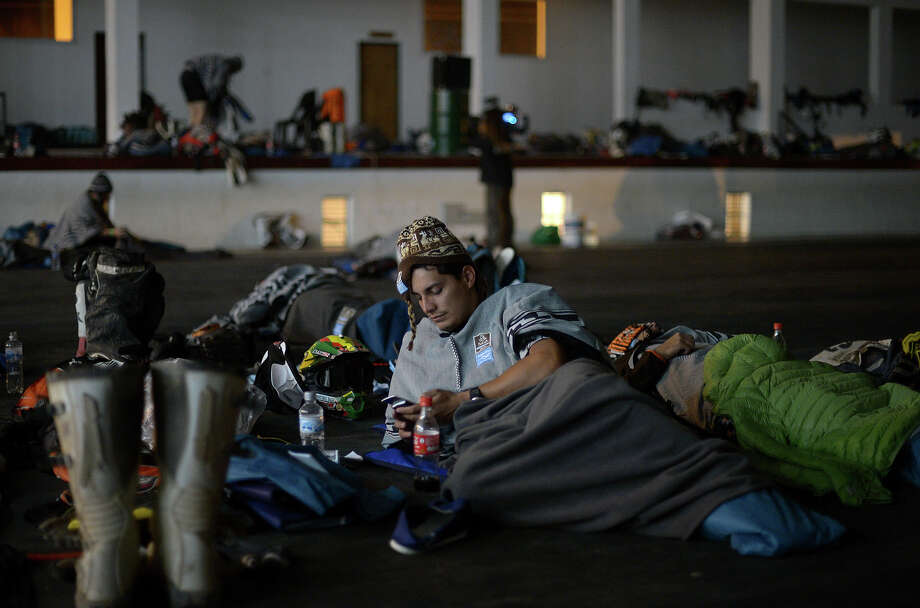 Competitors rest in Cachi after the Stage 7 of the Dakar 2013 between Calama and Salta, Argentina, on January 11, 2013. The rally will take place in Peru, Argentina and Chile January 5-20. Photo: FRANCK FIFE, AFP/Getty Images / 2013 AFP
