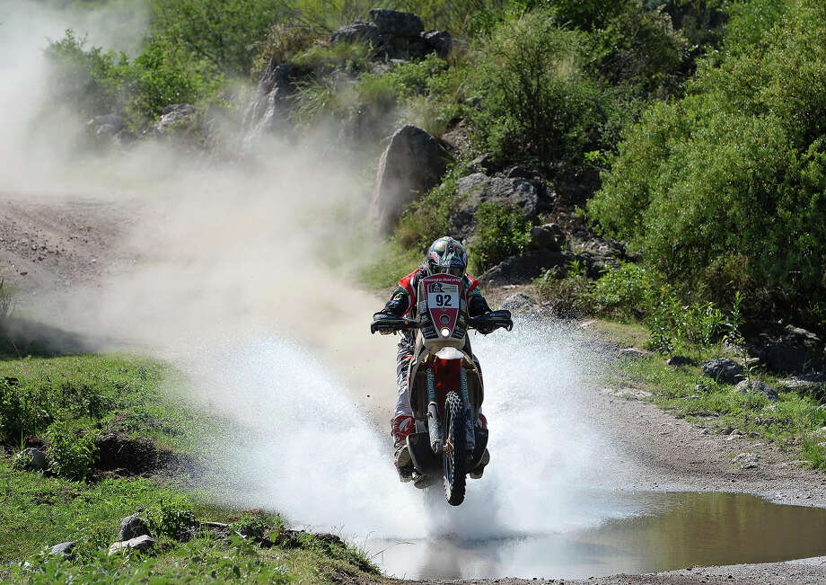 Honda's rider Jeremias Israel Esquerre of Chile competes during the Stage 9 of the Dakar 2013 between Tucuman and Cordoba, Argentina, on January 14, 2013. The rally takes place in Peru, Argentina and Chile between January 5 and 20. Photo: FRANCK FIFE, AFP/Getty Images / 2013 AFP
