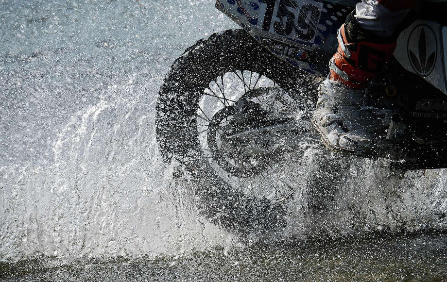 A biker competes during the Stage 10 of the Dakar 2013 between Cordoba and La Rioja, Argentina, on January 15, 2013. The rally takes place in Peru, Argentina and Chile between January 5 and 20. Photo: FRANCK FIFE, AFP/Getty Images / 2013 AFP
