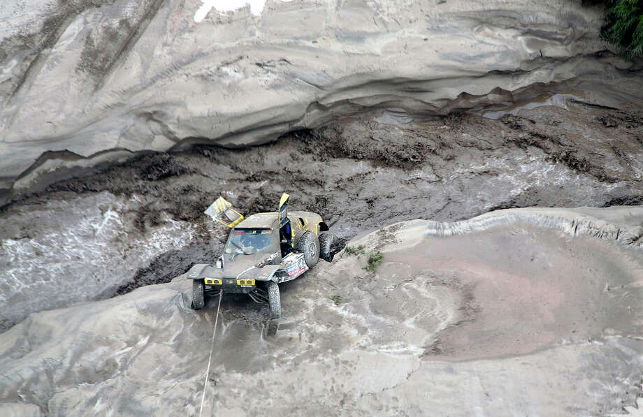 View of the car of French Pacal Thomasse stuck during the Stage 11 of the Dakar 2013 between La Rioja and Fiambala, Argentina, on January 16, 2013. The rally takes place in Peru, Argentina and Chile between January 5 and 20. Photo: POOL, AFP/Getty Images / 2013 AFP