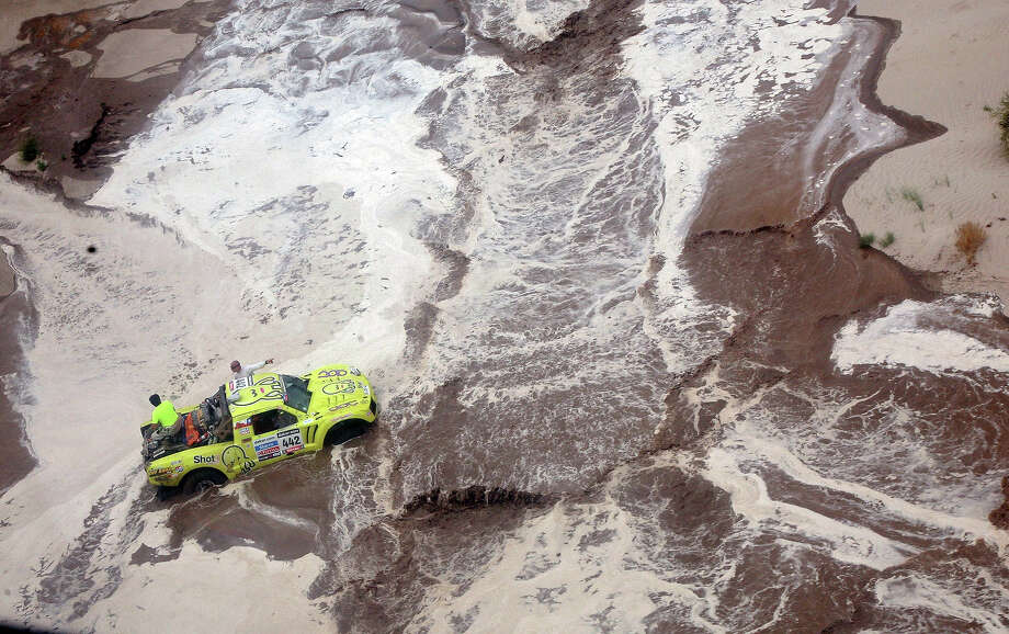 Argentina's Victor Mastromatteo remains stuck on his Protoptipo in a river during the Stage 11 of the Dakar 2013 between La Rioja and Fiambala, Argentina, on January 16, 2013. The rally takes place in Peru, Argentina and Chile between January 5 and 20. Photo: POOL, AFP/Getty Images / 2013 AFP