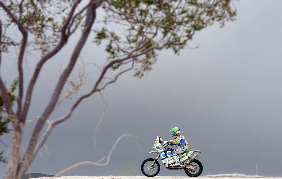 KTM's Brazilian Jean Azevedo competes during the Stage 11 of the Dakar 2013 between La Rioja and Fiambala, Argentina, on January 16, 2013. The rally takes place in Peru, Argentina and Chile between January 5 and 20. Photo: FRANCK FIFE, AFP/Getty Images / 2013 AFP