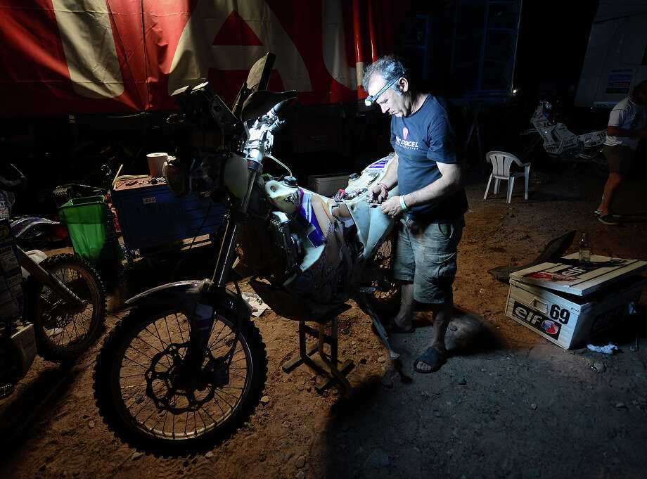 Hugo Payen of team Dorcel works on his bike after completing stage 11 from La Rioja to Fiambala during the 2013 Dakar Rally on January 16 in Fiambala, Argentina. Photo: Shaun Botterill, Getty Images / 2013 Getty Images