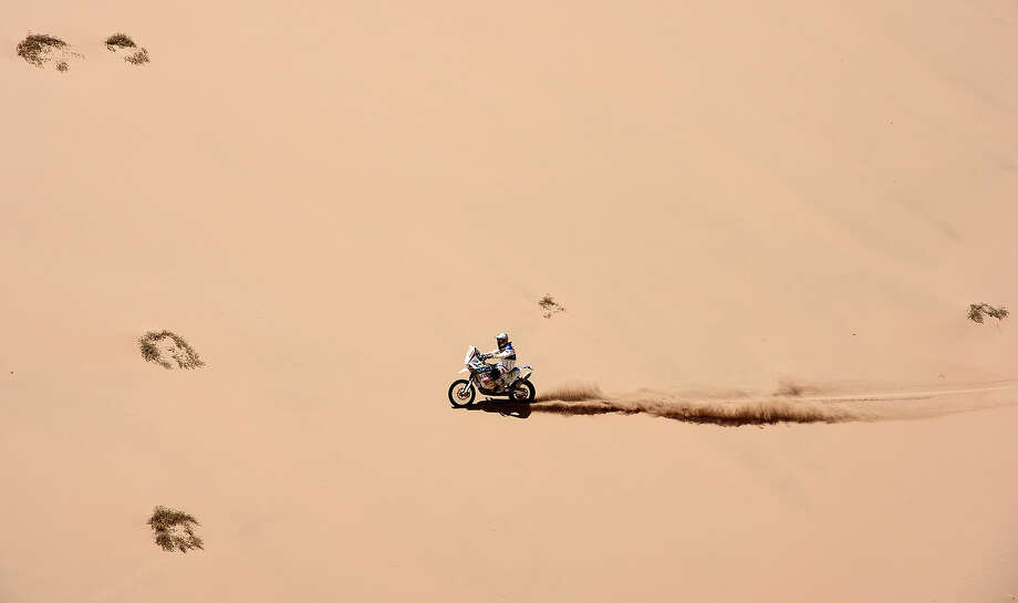 KTM?s rider Francisco Chaleco Lopez of Chile competes during the Stage 12 of the Dakar 2013 between Fiambala, Argentina and Copiapo, Chile, on January 17, 2013. The rally takes place in Peru, Argentina and Chile between January 5 and 20. Photo: FRANCK FIFE, AFP/Getty Images / 2013 AFP