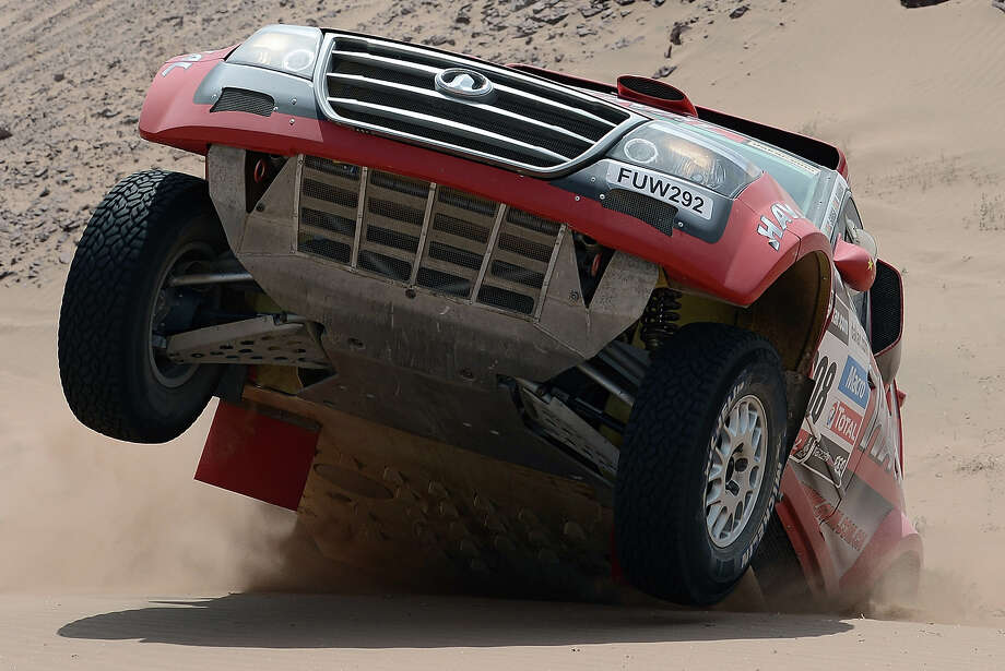 Portugal's Carlos Souza competes on his Great Wall during the Stage 12 of the Dakar 2013 between Fiambala, Argentina and Copiapo, Chile, on January 17, 2013. The rally takes place in Peru, Argentina and Chile between January 5 and 20. Photo: FRANCK FIFE, AFP/Getty Images / 2013 AFP