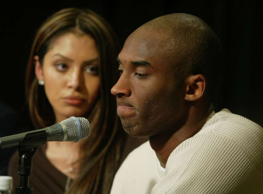 FILE — Police arrested L.A. Lakers star Kobe Bryant in July 2003 after a woman accused him of raping her at a hotel. With his wife, Vanessa, by his side, Bryant admitted to adultery (pictured) but insisted the sexual encounter was consensual. The case against him was eventually dropped in September 2004, and Bryant also settled a civil lawsuit over the alleged incident. Photo: J. Emilio Flores, Getty Images / Getty Images
